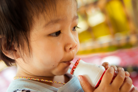 pasteurized: close up baby drinking pasteurized milk