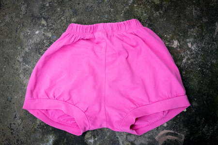 pink baby pant on black background Stock Photo