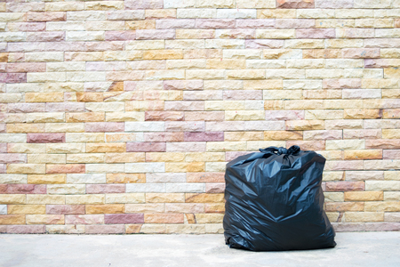 Garbage bag on brick wall background texture