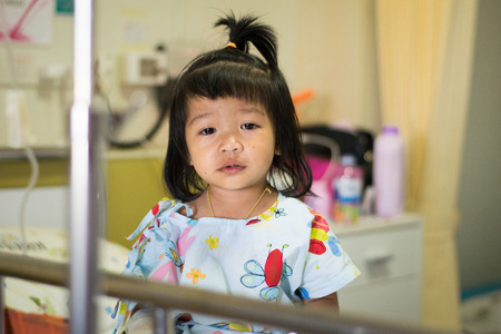 sick girl patient on hospital bed