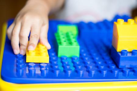 child playing colorful toys on table Reklamní fotografie