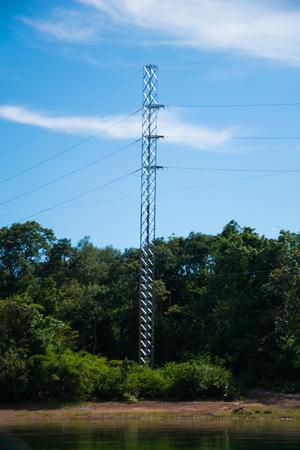 landscape of electric pole on river side