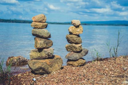 praying layers of stone on river side Reklamní fotografie