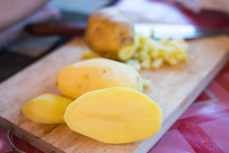 fresh potato slice on wooden board