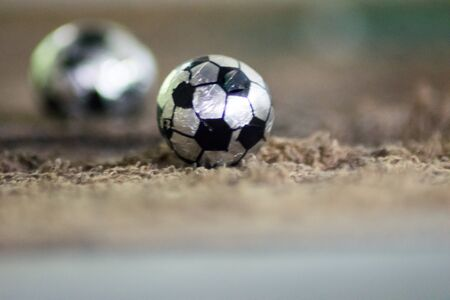 football soccer on brown background