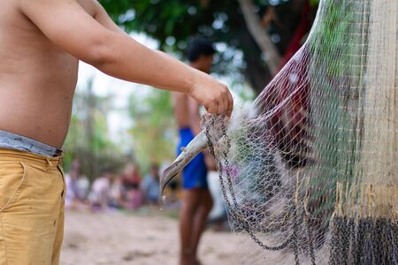 fisher man with fishing net