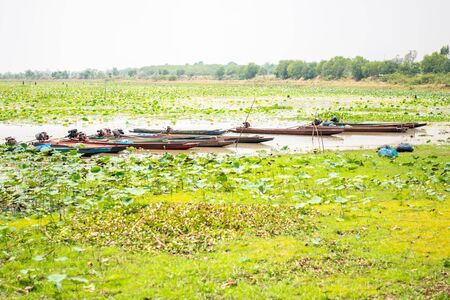 landscape view of river with fishing boat in thailand