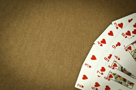 rummy: Heart Cards 13 cards on the table brown plywood boards