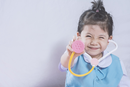 Little Asian Girl and Stethoscope toy with Doctor concept copy space. Stock Photo