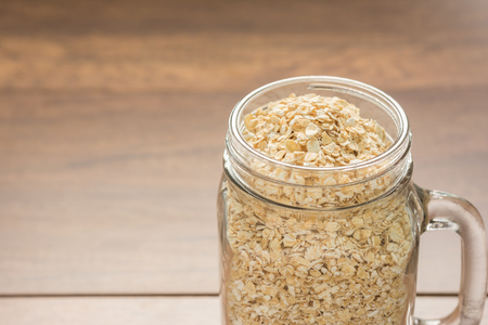 Close up Oats Dry Seed In a well-preserved jar ready to serve breakfast for the family. with Space for Text.