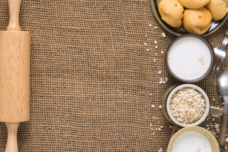 Various types of ingredients for breakfast and Rolling Pin. These are foods that give energy to everyone in the family.Set on a sack of warmth. with Space for Text.                Foto de archivo