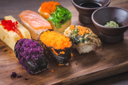 Sushi is one of the most popular Japanese dishes. on Wooden Cutting Board in Japanese style. Foto de archivo