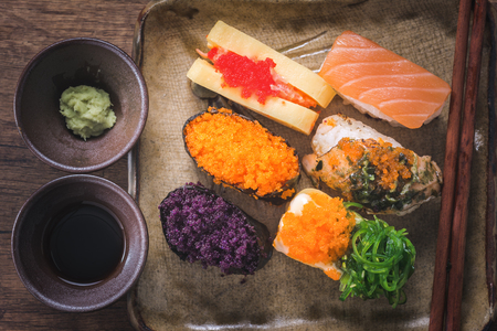 Sushi is one of the most popular Japanese dishes. Placed on plates and containers in Japanese style.