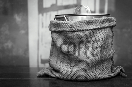 Close up  Stainless Steel Bucket that Holds Coffee Beans Wrapped in Sacks. with Space for Text. Foto de archivo