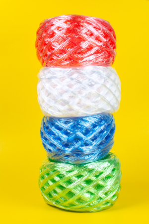 Close up Plastic rope four Color. on yellow Background.For tie items are popular. And is made of plastic.