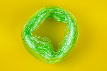 Top View of Green Plastic rope. on yellow Background.For tie items are popular. And is made of plastic. Foto de archivo
