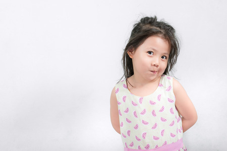 Portrait Little Thai Beautiful girl in pink watermelon Drees. on White Background .with space for text. Foto de archivo