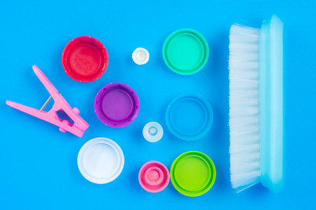 Products made of plastic are arranged on Blue background. We use it in everyday life.