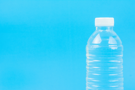 Close up Bottle of drinking water. on Blue Background. with space for text.