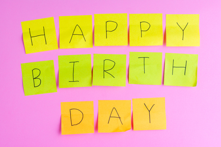 Handwriting happybirthday on post it. about important dates concept.