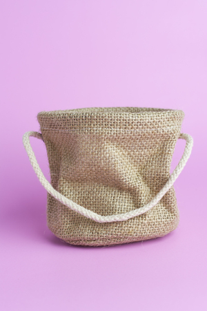 Small Sack bag on pink paper with a lovely cute. Which is the place to put. And a table decoration.