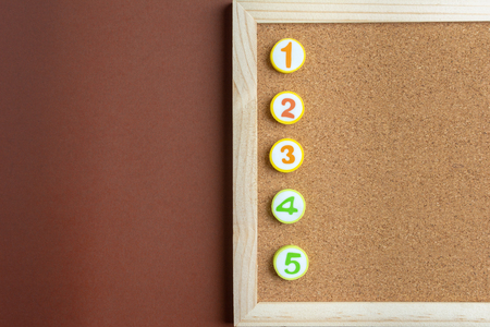 Job to Do List with Numbers on Notice Board on brown background.