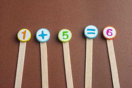 One Plus Five Equals Six on Wooden Ice Cream Stick ,Using for Homeschooling Concept Learning.