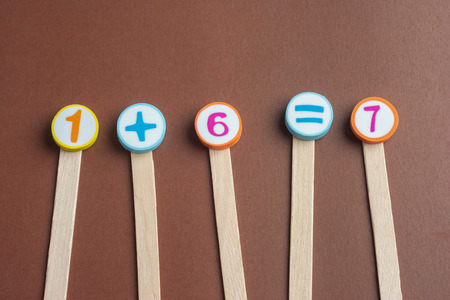 One Plus Six Equals Seven on Wooden Ice Cream Stick ,Using for Homeschooling Concept Learning. Foto de archivo