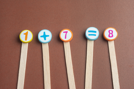 One Plus Seven Equals Eight on Wooden Ice Cream Stick ,Using for Homeschooling Concept Learning.