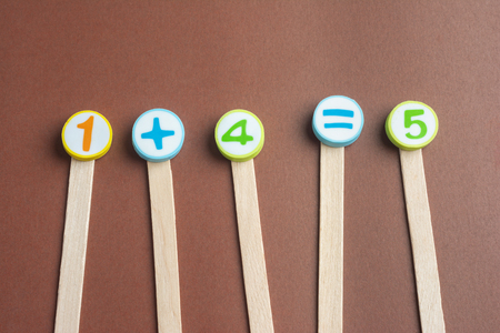 One Plus Four Equals Five on Wooden Ice Cream Stick ,Using for Homeschooling Concept Learning. Foto de archivo