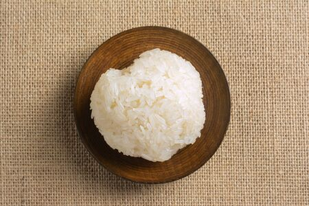 Sticky rice on wooden plate thai recipe.