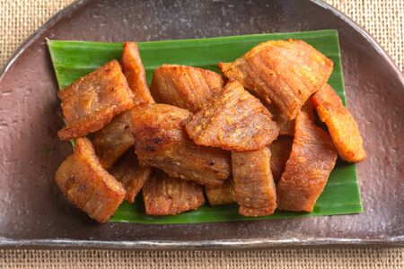 Top View of Fried Pork on Banana Leaves Thai Recipe.