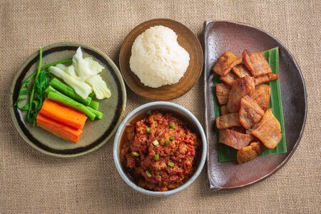 Top View of Thai food with spicy taste can be eaten with vegetables. For the nutritional benefits on wooden background.