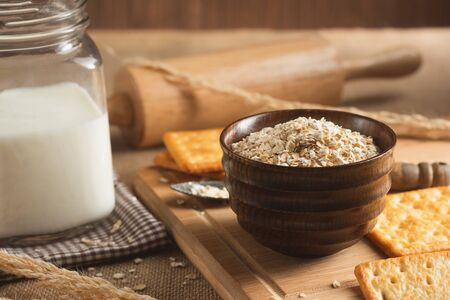Close up of Biscuits, Oat cereals, and Milk on the Wooden Table for Breakfast. Фото со стока