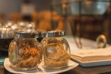Close-up of sugar In a glass jar contemporary coffee shops with space for text.