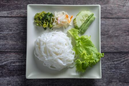Top View of Thai Rice Noodles and Vegetables on Wihte Plate Asian food for health. Фото со стока