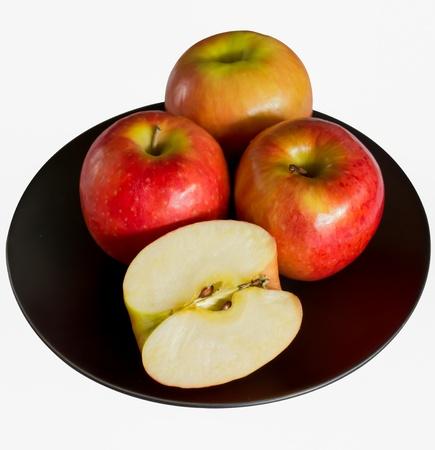 Apples on The Blackdish on White Background