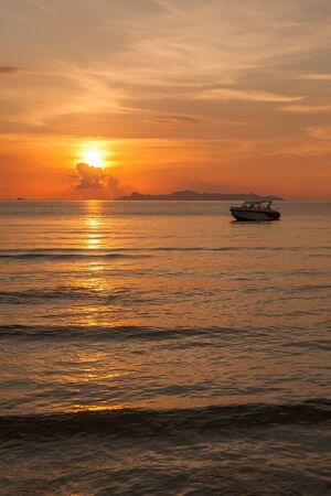 Boats on the sea at sunset