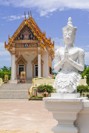 Prayer statue in front of the temple