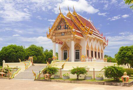 Thai temple on blue sky background Stock Photo