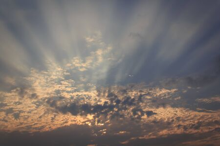 Sun light through the clouds Stock Photo
