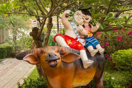children and buffalo statue
