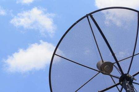 Satellite dish in sky Stock Photo