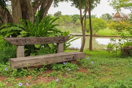 Wooden bench in garden