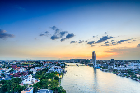 river scape: City scape at twilight in Bangkok beside Chopraya river, Thailand