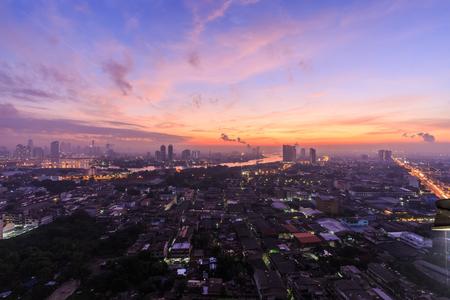 Bangkok,Thailand-Nov 14.LPN costly condominium at dusk with Chao Phraya river with cloud and sun raise on Nov 14,2015 Publikacyjne