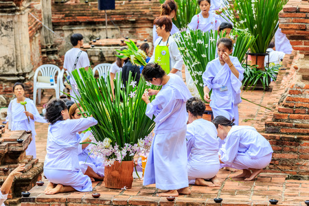 venerate: AYUTHAYA THAILAND : July 30 : People go to decorate   temple area in evening wat Mahayong important temple in Ayuthaya Provice central of thailand on July 30,2015