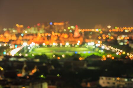 Blur image or bokeh light of Emerald temple in night scenery. Publikacyjne
