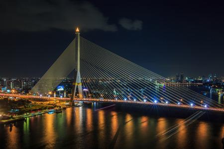 viii: Rama VIII Bridge at night in Bangkok and Chopraya river, Thailand Editorial