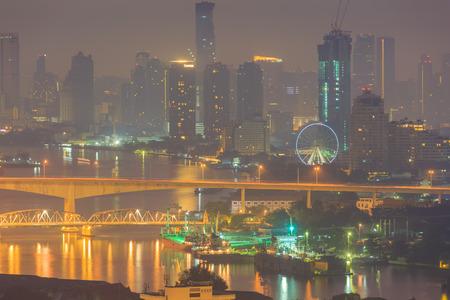 Bangkok,Thailand-Nov 14.Bangkok at dusk with Chao Phraya river with cloud and sun raise on Nov 14,2015 Publikacyjne